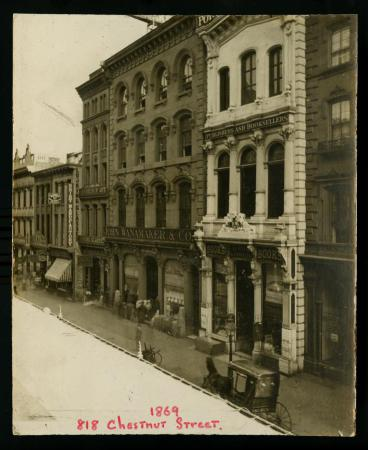 Photograph is of the facade of the John Wanamaker & Co. building at 1818 Chestnut Stree. Several other buildings are visible, and a horse-drawn carriage is located in the lower left corner. 1869-85. From the John Wanamaker collection [2188]